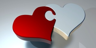 A computer-generated render of two 'heart' shapes, one white and one read, fitting together as puzzle pieces.